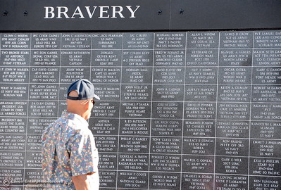 People gather and peruse through names on the Wall of Honor during the Oroville Veterans Memorial Park opening ceremony Friday July 28, 2017. (Bill Husa -- Enterprise-Record)
