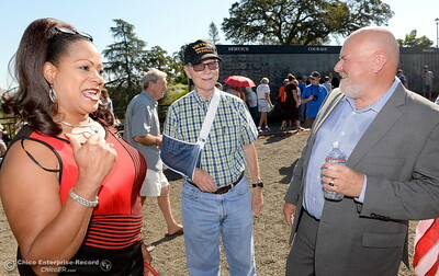 Janet Goodson, Larry Wahl and Bill Connelly share a moment following the Oroville Veterans Memorial Park opening ceremony Friday July 28, 2017. (Bill Husa -- Enterprise-Record)