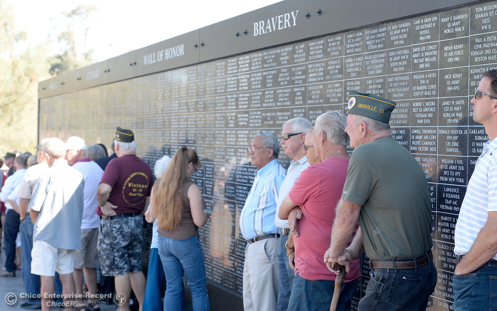 . Second from right, Veteran Earl Quigley stands beside the Wall of Honor during the Oroville Veterans Memorial Park opening ceremony Friday July 28, 2017. (Bill Husa -- Enterprise-Record)