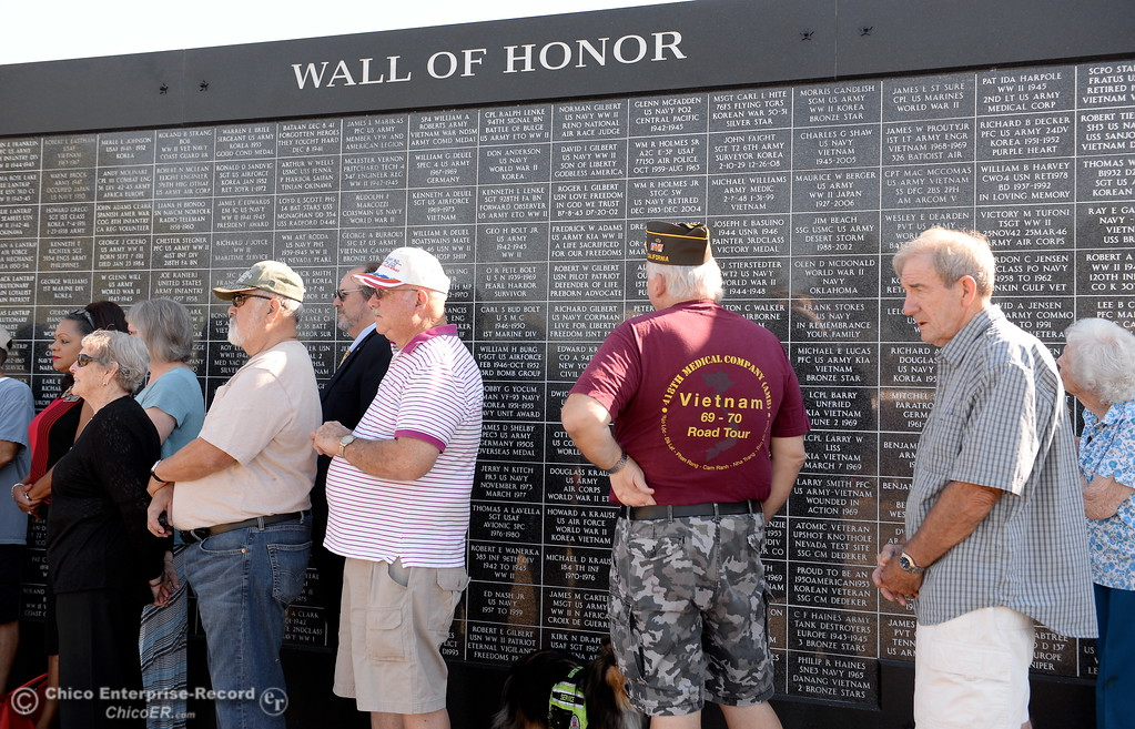 . People gather at the Wall of Honor during the Oroville Veterans Memorial Park opening ceremony Friday July 28, 2017. (Bill Husa -- Enterprise-Record)
