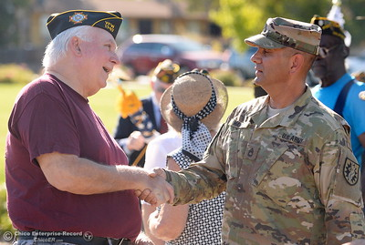 Veterans Joe Baker left and Daniel Madrid greet each other during the Oroville Veterans Memorial Park opening ceremony Friday July 28, 2017. (Bill Husa -- Enterprise-Record)