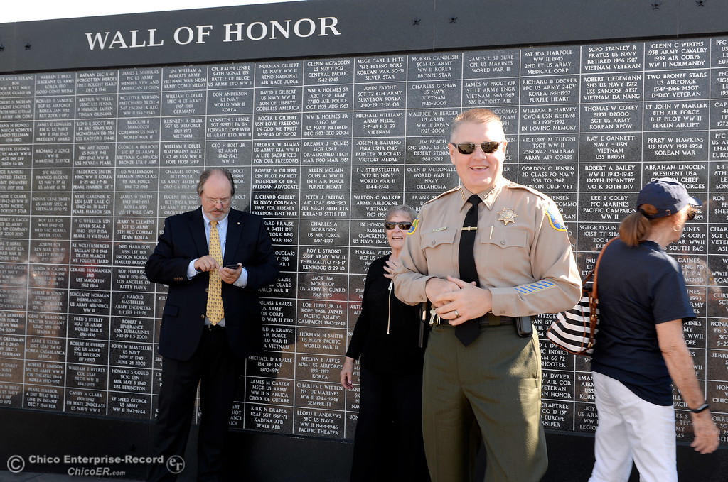 . Butte County Sheriff Kory Honea greets people near the Wall of Honor during the Oroville Veterans Memorial Park opening ceremony Friday July 28, 2017. (Bill Husa -- Enterprise-Record)