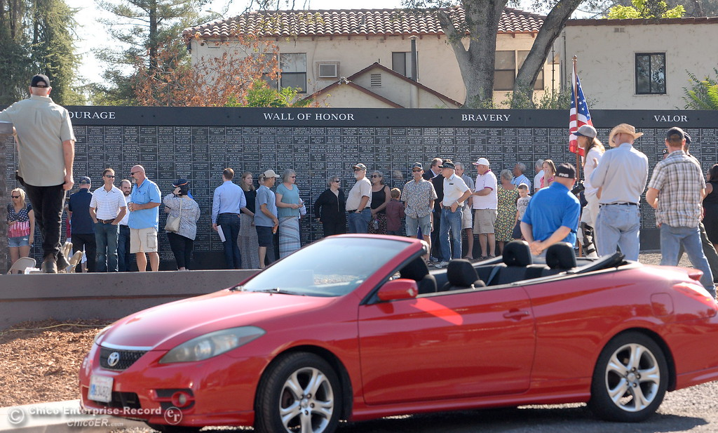 . People gather around the wall just prior to the Oroville Veterans Memorial Park opening ceremony Friday July 28, 2017. (Bill Husa -- Enterprise-Record)