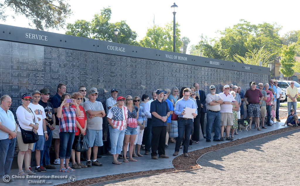 . A crowd gathers in the shade of the Wall of Honor during the Oroville Veterans Memorial Park opening ceremony Friday July 28, 2017. (Bill Husa -- Enterprise-Record)