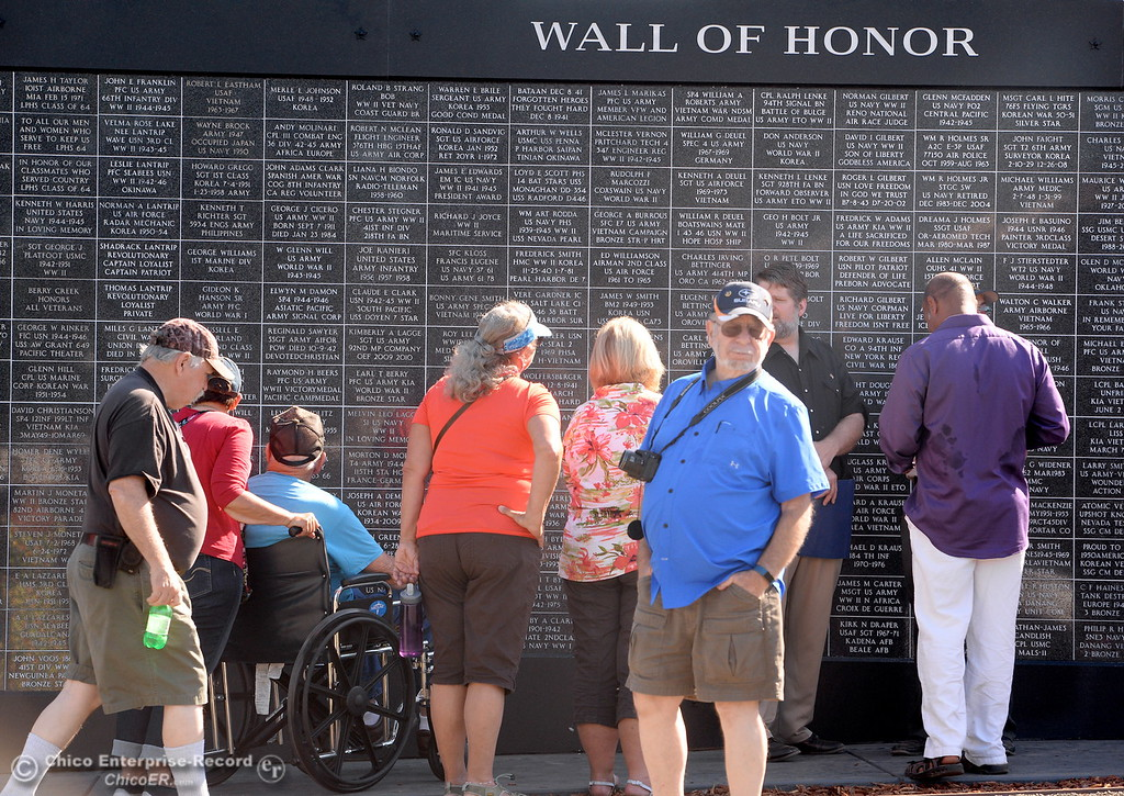 . People gather and peruse through names on the Wall of Honor during the Oroville Veterans Memorial Park opening ceremony Friday July 28, 2017. (Bill Husa -- Enterprise-Record)