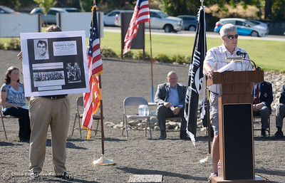 A portrait of Veteran Richard V. Curtis is shown as Don Noble tells his story during the Oroville Veterans Memorial Park opening ceremony Friday July 28, 2017. (Bill Husa -- Enterprise-Record)