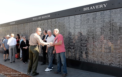 Butte County Sheriff Kory Honea greets people near the Wall of Honor during the Oroville Veterans Memorial Park opening ceremony Friday July 28, 2017. (Bill Husa -- Enterprise-Record)