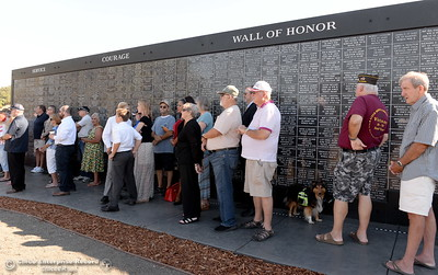 People gather at the Wall of Honor during the Oroville Veterans Memorial Park opening ceremony Friday July 28, 2017. (Bill Husa -- Enterprise-Record)