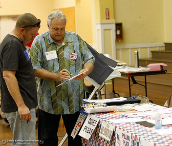 Poll worker Skip West talks with a voter during the 2016 election November 8, 2016 at the Feather River Municipal Center in Oroville, California. (Emily Bertolino -- Mercury Register)