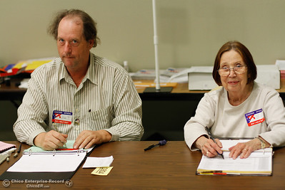 Poll workers Jim Tekrony and Pat Koskinen check voters in and hand out their ballots November 8, 2016 at the Southside Community Center in Oroville, California. (Emily Bertolino -- Mercury Register)