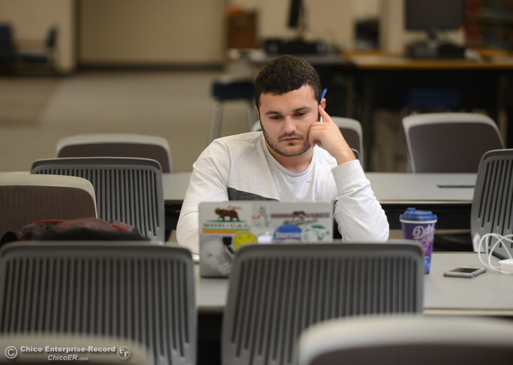. Landon Akhtar works on his strategic management homework Thursday January 11, 2018 at CSU Chico in Chico, California. (Emily Bertolino -- Enterprise-Record)