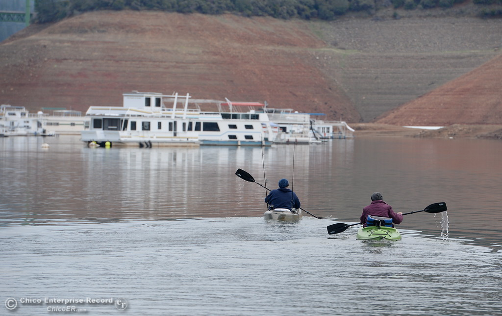 ". Trisha and Jim Shear of Magalia smile as they head out onto Lake Oroville in their kayaks from the Bidwell Canyon Marina launch facility Thursday Jan. 11, 2018. ""We\'re just happy that we can find some place we can get in the water\"" said Trish.  (Bill Husa -- Enterprise-Record)"