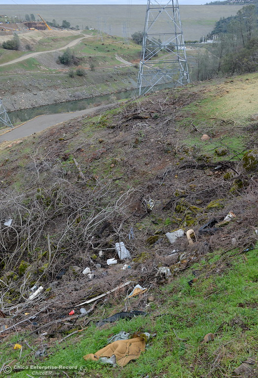 . Garbage mixes with brush in a drainage near the Hyatt Powerhouse along Oroville Dam Blvd. East in Oroville, Calif. Jan. 11, 2018.  (Bill Husa -- Enterprise-Record)