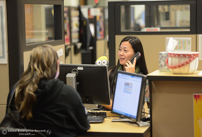 Mai Xiong helps a student sign up for classes at the Butte College Welcome Center Thursday January 11, 2018 in Chico, California. (Emily Bertolino -- Enterprise-Record)