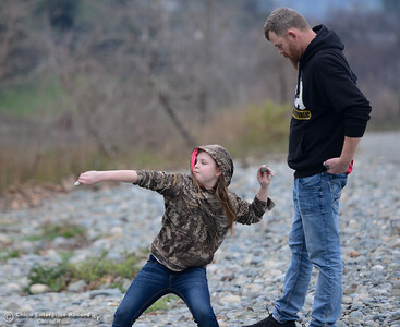 Patience, 9, and Bill Cross practice skipping rocks Tuesday January 16, 2018 at Riverbend Park in Oroville, California. (Emily Bertolino -- Enterprise-Record)