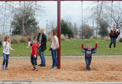 It's a busy day at Riverbend Park as the King-Romaguera family swings  Tuesday January 16, 2018 in Oroville, California. (Emily Bertolino -- Enterprise-Record)