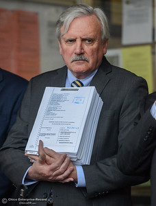 James Nolan holds up the lawsuit that the city of Oroville filed against the state Department of Water Resources for the Oroville Dam crisis Wednesday January 17, 2018 at Oroville City Hall in Oroville, California. (Emily Bertolino -- Enterprise-Record)