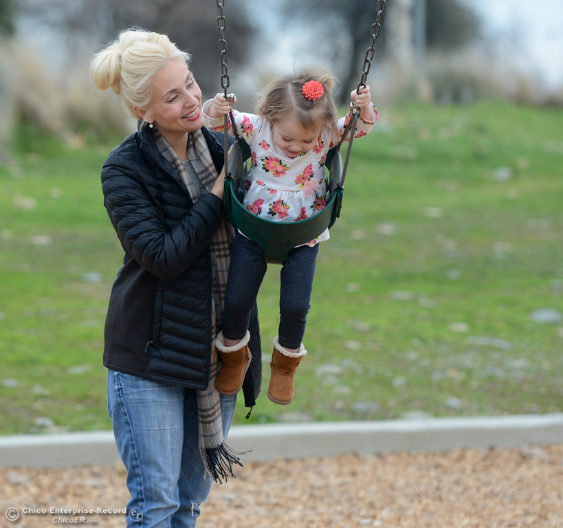 . Jenae King Romaguera pushes her daughter Genevieve, 22 months, on the swing Tuesday January 16, 2018 at Riverbend Park in Oroville, California. (Emily Bertolino -- Enterprise-Record)