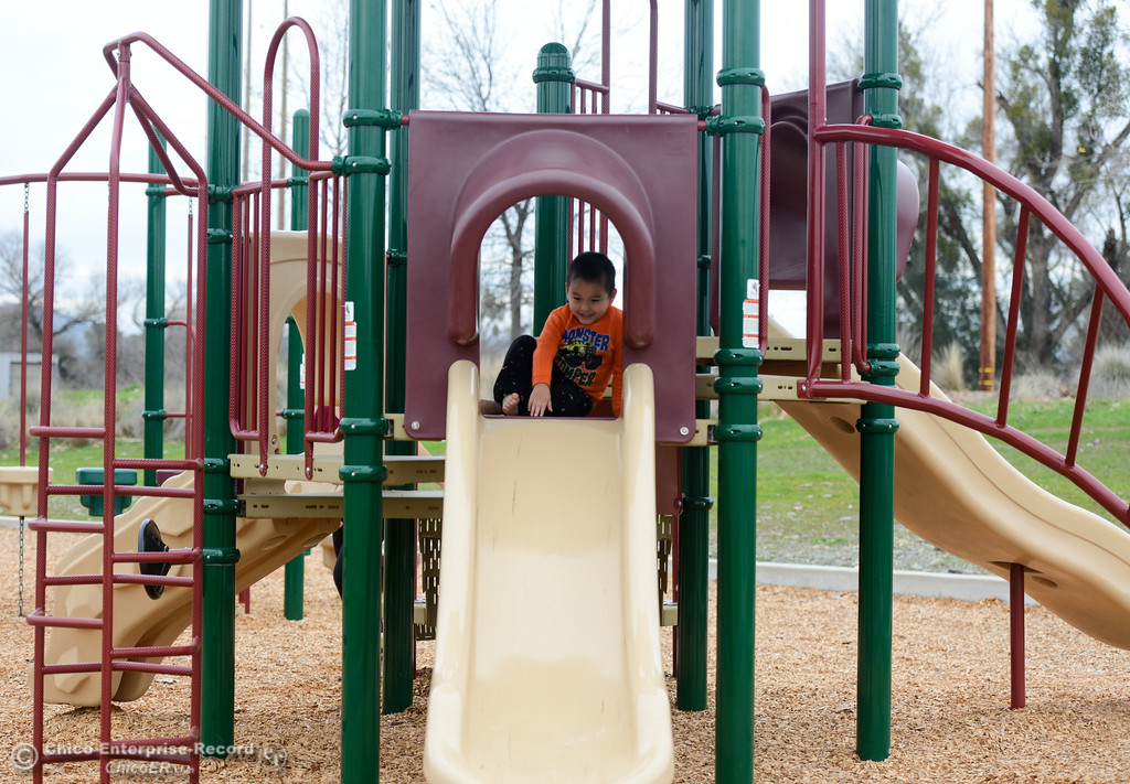 . Mason Vang, 3, plays on the playground at Riverbend Park Tuesday January 16, 2018 in Oroville, California. (Emily Bertolino -- Enterprise-Record)