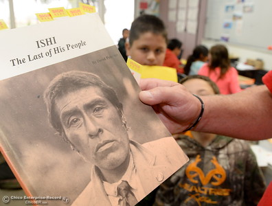 Poplar Avenue School Teacher Allen Kreitzer holds a book as his students learn about Ishi in Oroville, Calif. Friday Oct. 14, 2016. (Bill Husa -- Enterprise-Record)