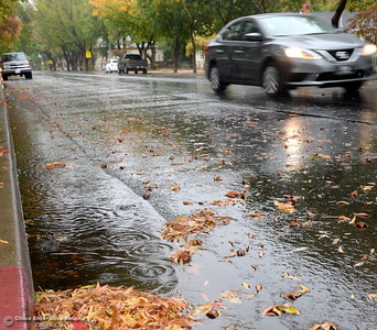 A car zips along Montgomery Street during the rain in Oroville, Calif. Friday Oct. 14, 2016. (Bill Husa -- Enterprise-Record)