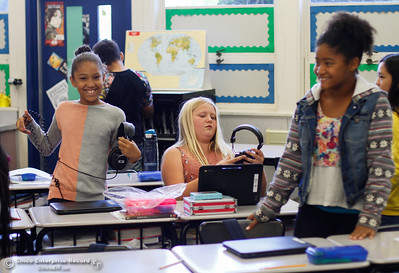 A group of sixth graders get out their Chromebooks for a lesson in history September 26, 2017 in Oroville, California. This is the first year sixth graders have been integrated into the middle school.