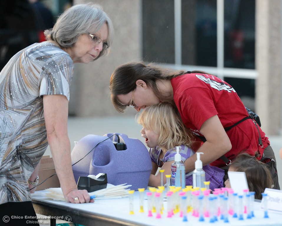 . Alyssa Manes holds up her daughter Hope, 3, to see the germs on her hands at the Oroville Hospital booth during the Explorers Faire  Wednesday September 27, 2017 at Butte College in Butte Valley, California. (Emily Bertolino -- Enterprise-Record)