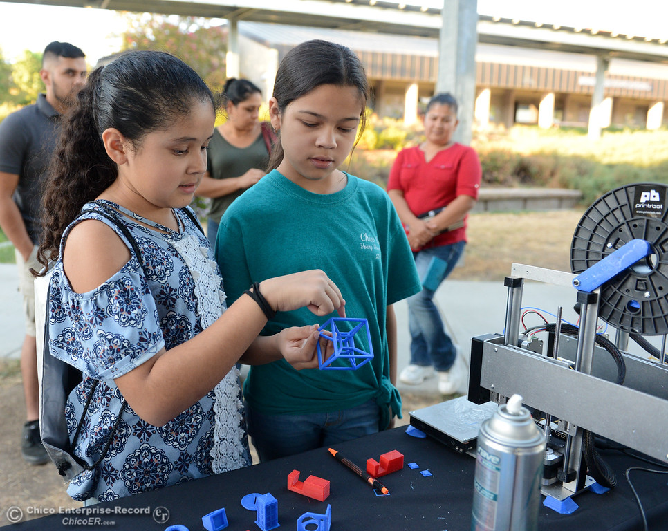 . Rebeca Chavez, 11, and Lluvia Garcia, 12, look at an object printed from a 3D printer during the Explorers Faire  Wednesday September 27, 2017 at Butte College in Butte Valley, California. (Emily Bertolino -- Enterprise-Record)