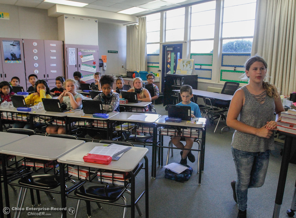 . Jordyn Rutenschroer, 11, reads through an assignment as the class follows along on their Chromebooks September 26, 2017 in Oroville, California. (Emily Bertolino -- Mercury Register)