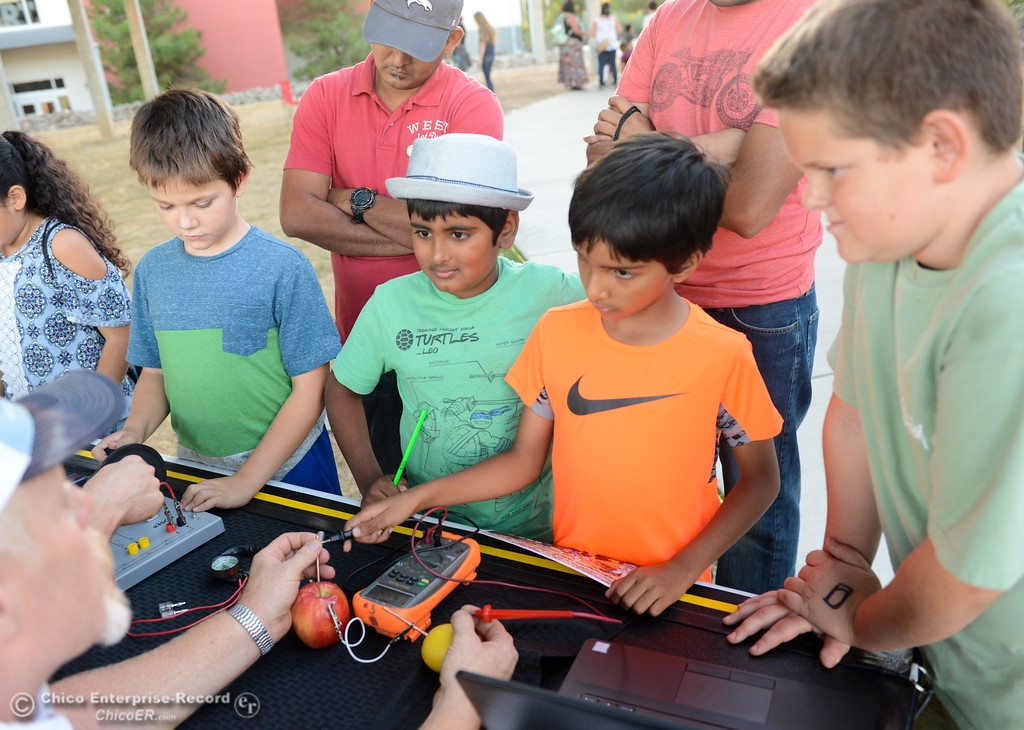 . Nikhil Pasya, 7, (center right) uses a multimeter to test the electrical flow through an apple and lemon as Adithya Gupta, 9, (center left) looks on during the Explorers Faire  Wednesday September 27, 2017 at Butte College in Butte, Valley, California. (Emily Bertolino -- Enterprise-Record)