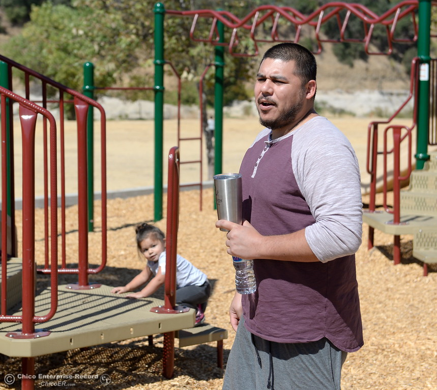 . Paul Sabala spends time with his 2-year-old daughter Nique Sabala on the playground at Riverbend Park in Oroville, Calif. Friday Sept. 22, 2017. (Bill Husa -- Enterprise-Record)