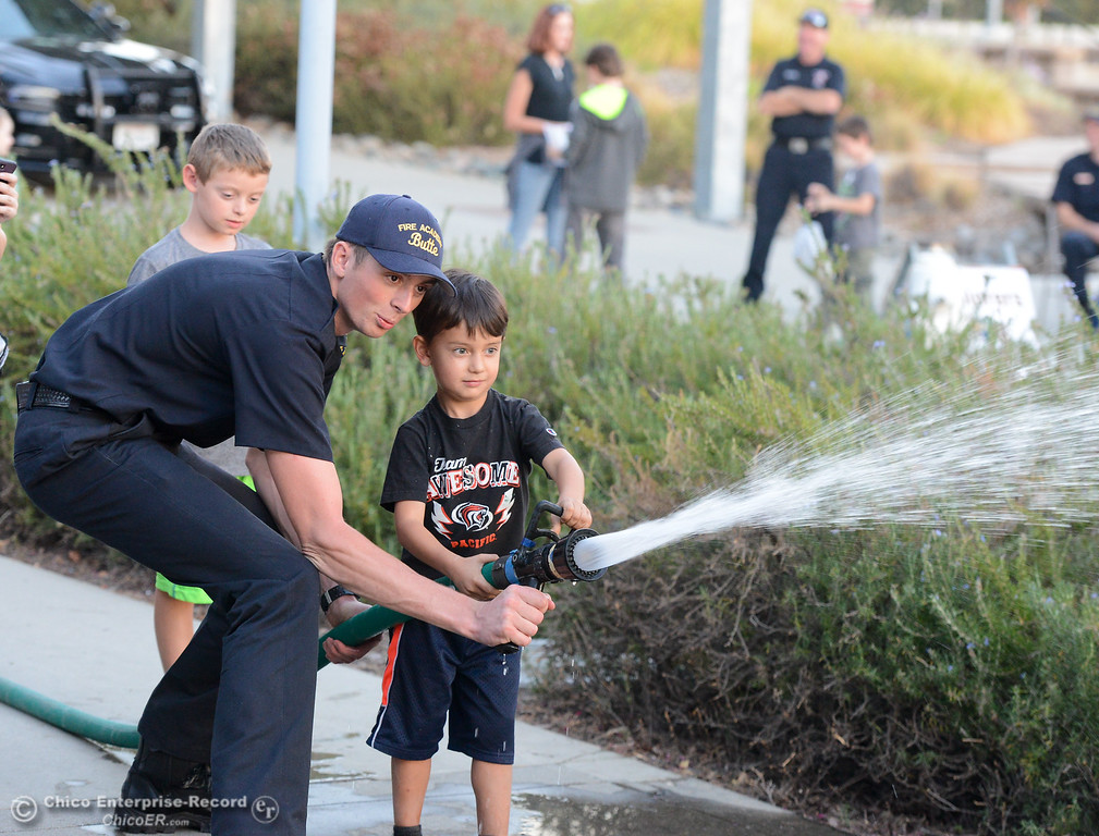 . Callan Hoiland, 5, uses a fire hose during the Explorers Faire  Wednesday September 27, 2017 at Butte College in Butte Valley, California. (Emily Bertolino -- Enterprise-Record)