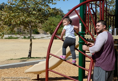 Paul Sabala spends time with his 2-year-old daughter Nique Sabala on the playground at Riverbend Park in Oroville, Calif. Friday Sept. 22, 2017. (Bill Husa -- Enterprise-Record)