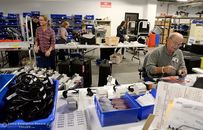 A specialized group of people prepare voting machines at the Butte County Clerk Recorder Hall of Records building in Oroville, Calif. Monday Oct. 24, 2016. (Bill Husa -- Enterprise-Record)