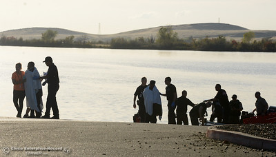 Two people wrapped in blankets are treated for possible hypothemia Wednesday, Oct. 26, 2016, after six people went in the water during a boating exercise at the Thermalito Forebay in Oroville, California. (Dan Reidel -- Mercury-Register)