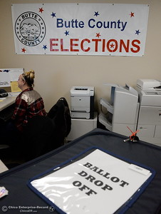 Marcie Roesche sits near a ballot drop off box at the Butte County Clerk Recorders Office Warehouse Reception Desk in Oroville, Calif. Monday Oct. 24, 2016. (Bill Husa -- Enterprise-Record)