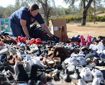Shannon Tiedeman helps organize shoe donations Saturday October 14, 2017 at the Bangor Community Church in Bangor, California. (Emily Bertolino -- Mercury-Register)