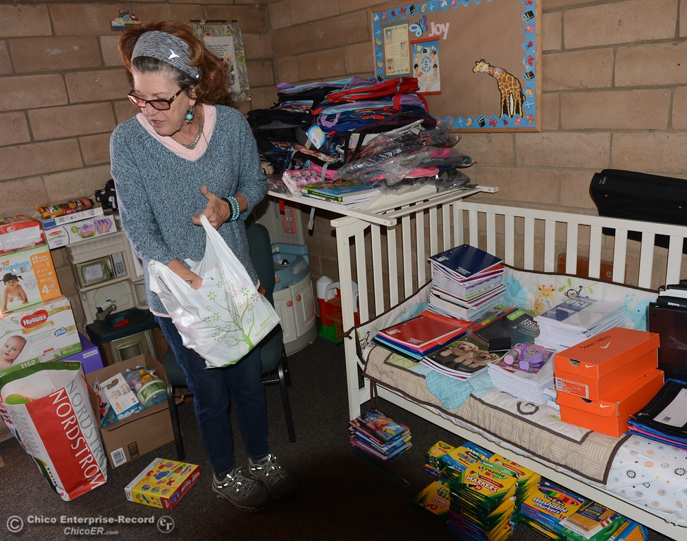 . Dru Otten sorts through school supplies donated to the people affected by the Bangor fire Saturday October 14, 2017 at the Bangor Community Church in Bangor, California. (Emily Bertol