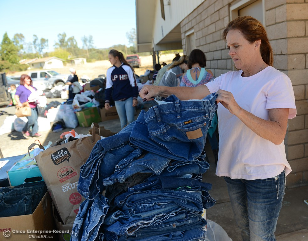 . Volunteers help sort through clothes donated to the Bangor fire victims Saturday October 14, 2017 at the Bangor Community Church in Bangor, California. (Emily Bertolino -- Mercury-Register)