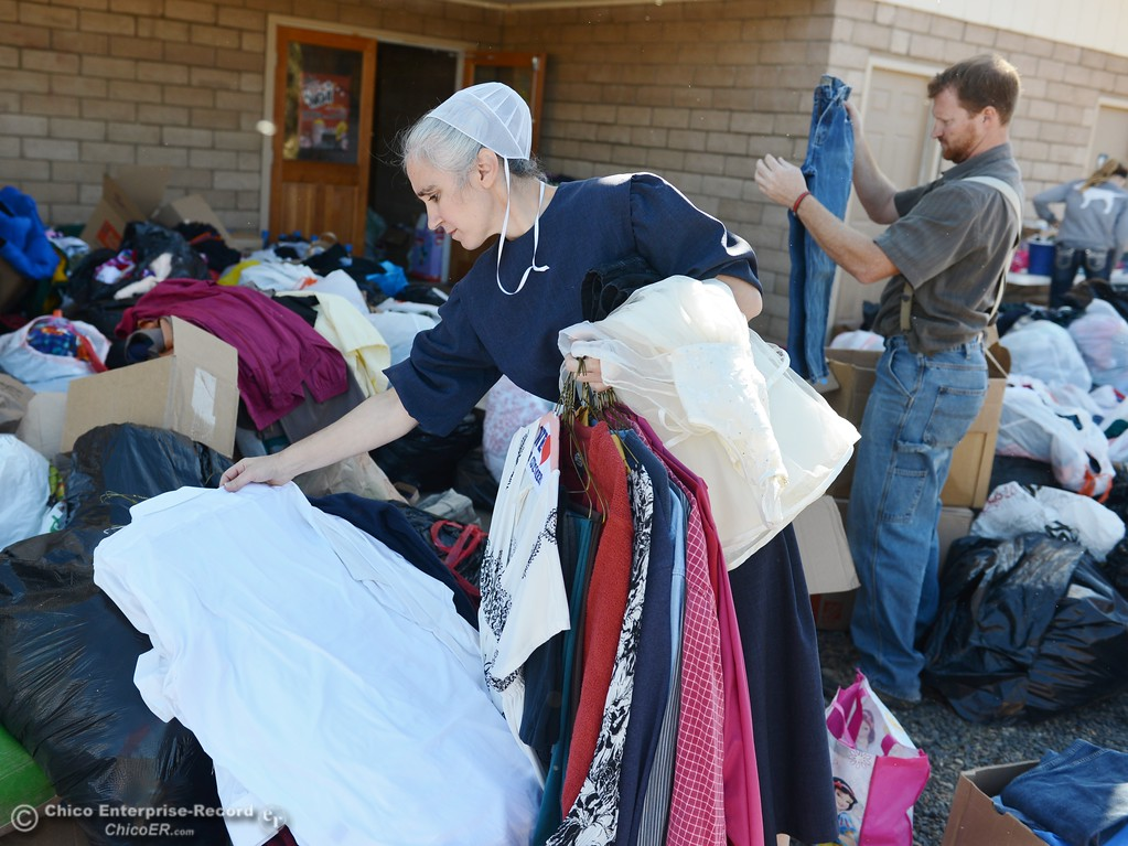 . Charity Graber and her husband Simon help sort through clothes donated to the Bangor fire victims Saturday October 14, 2017 at the Bangor Community Church in Bangor, California. (Emily Bertolino -- Mercury-Register)