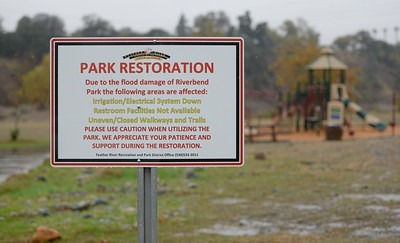A park restoration sign is seen at Riverbend Park as rain falls in Oroville, Calif. Wednesday Nov. 15, 2017. (Bill Husa -- Enterprise-Record)