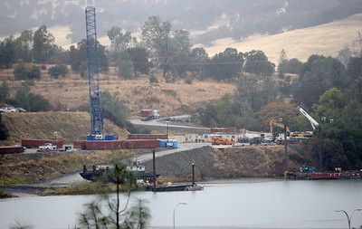 Cranes appear busy at work near the Thermalito Diversion Dam seen here from the parking lot of the Lakeland Blvd. trailhead in  Oroville, Calif. Wednesday Nov. 15, 2017. (Bill Husa -- Enterprise-Record)