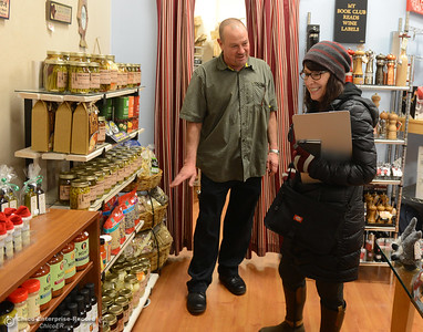 Manny Muellenbach, left, and Heather Johnson , right, talk about items for sale in The Galley as a group of economic development and business advocates visits Muellenbach at his shop in downtown Oroville during the monthly Oroville Strong! Business Walk on Friday, Dec. 9, 2016 in Oroville, California. (Dan Reidel -- Enterprise-Record)