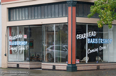 Signs for a new barber shop on the corner of Montgomery and Huntoon Street sprung up quickly after the bike shop closed December 8, 2016 in Oroville, California. (Emily Bertolino -- Mercury Register)