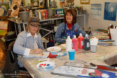 Kellie Marvel and Debbie Peck paint Santa's on wooden boards at Brushstrokes December 8, 2016 in Oroville, California. The art studio and gallery has been doing really well since they opened in October. (Emily Bertolino -- Mercury Register)