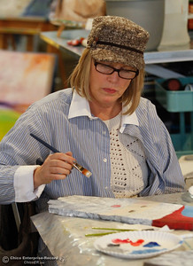 Kellie Marvel works on a Santa painting at Brushstrokes Art Studio and Gallery December 8, 2016 in Oroville, California. Brushstrokes has been doing well since their opening in October. (Emily Bertolino -- Mercury Register)