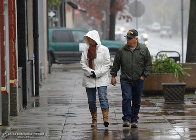 The rain didn't stop this couple from taking a stroll downtown and doing a little shopping December 8, 2016 in Oroville, California. (Emily Bertolino -- Mercury Register)