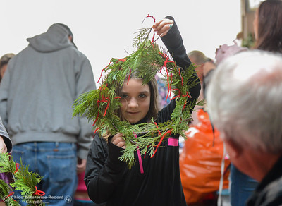 Lana Branum, 7, holds up a wreath she made as people partake in frontier crafts during Frontier Christmas Saturday December 2, 2017 at the at Lake Oroville Visitor Center in Oroville, California. (Emily Bertolino -- Mercury Register)