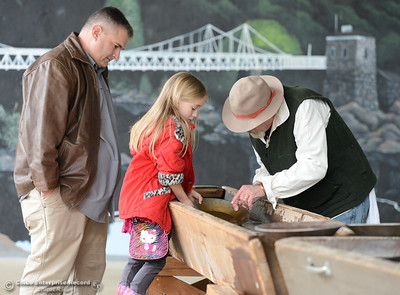 Children learn how to pan for gold during Frontier Christmas Saturday December 2, 2017 at the at Lake Oroville Visitor Center in Oroville, California. (Emily Bertolino -- Mercury Register)