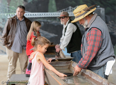 Foster Car shows Jasmine how to pan for gold during Frontier Christmas Saturday December 2, 2017 at the at Lake Oroville Visitor Center in Oroville, California. (Emily Bertolino -- Mercury Register)